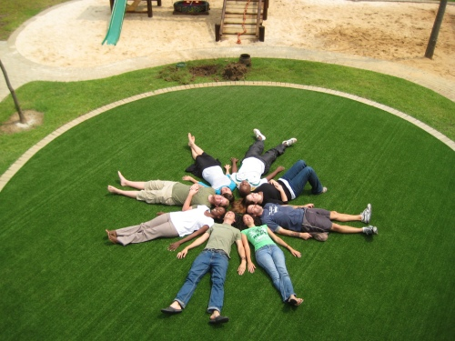 Fake astroturf makes for a sweet Apprentice pic! (Clockwise from me in army green: Me, Adrienne, Oupa, Melanie, Tony, Colletta, Curtis, Busi)