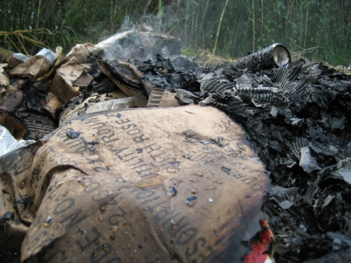 Burning rubbish as a metaphor for deconstruction equaling newly beautiful life?