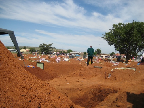 Alone in a sea of endless graves.  A typical Soshanguve Saturday morning at the cemetery.
